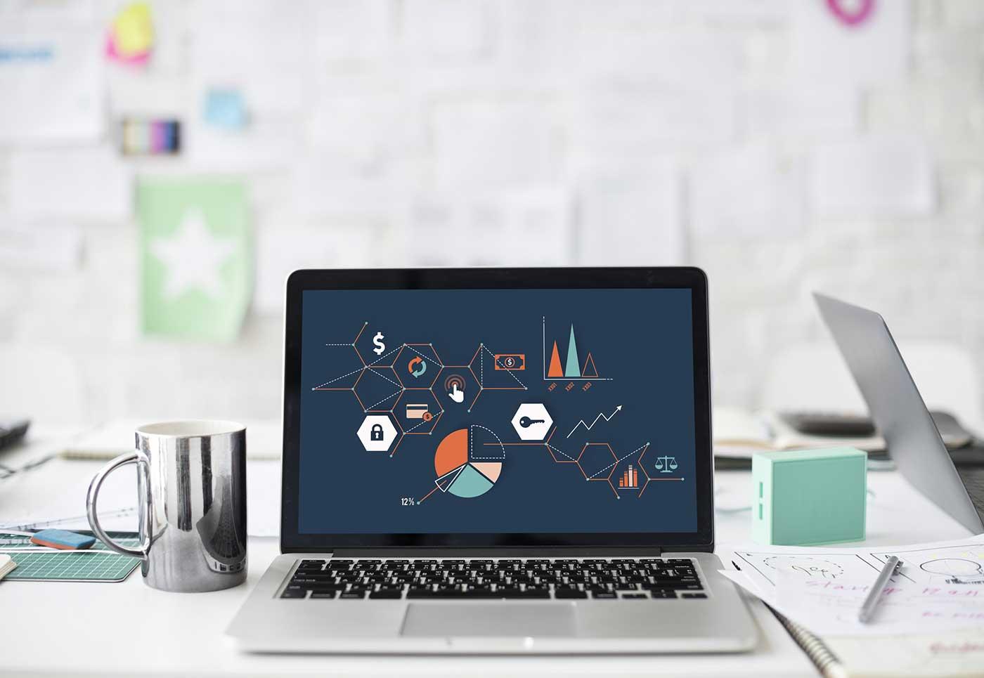Laptop on the desk shows web design process at webcraff uk