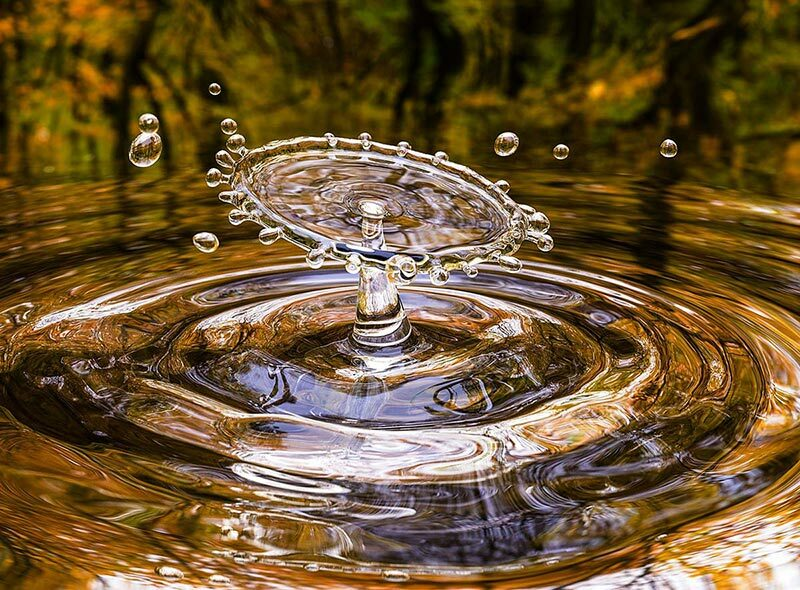 Crisp Picture Showing Water Drop Falling in to the Lake refers to Razor Sharp Website Graphics.